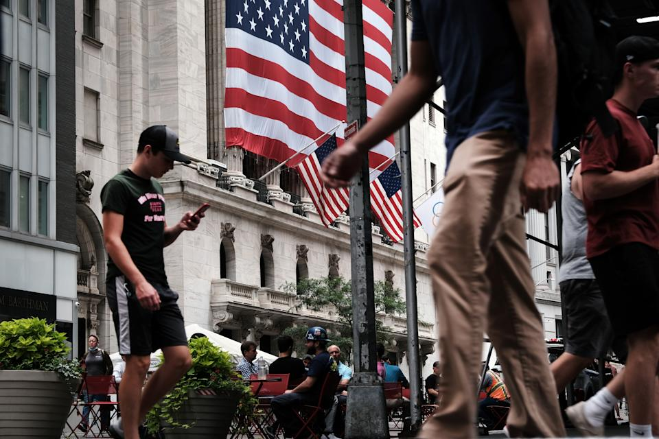 NEW YORK, NEW YORK - AUGUST 10: People walk by the New York Stock Exchange (NYSE) on August 10, 2021 in New York City. Markets were up in morning trading as investors look to a rare bipartisan effort in the Senate to pass a massive infrastructure bill that, if passed, will infuse billions into the American economy. (Photo by Spencer Platt/Getty Images)