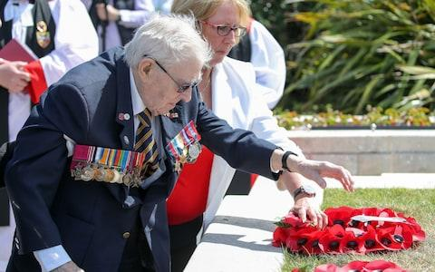 Jimmy Ockendon lays a wreath at the D-Day stone in Southsea - Credit: Andrew Matthews/PA