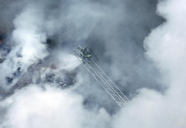 <p>Firefighters try to extinguish a fire at a building in downtown Sao Paulo, Brazil, May 1, 2018. (Photo: Paulo Whitaker/Reuters) </p>