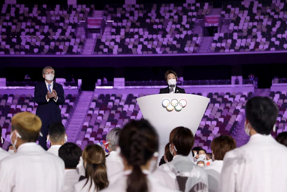<p>TOKYO, JAPAN - JULY 23: Seiko Hashimoto, Tokyo 2020 President makes a speech as Thomas Bach, IOC President looks on during the Opening Ceremony of the Tokyo 2020 Olympic Games at Olympic Stadium on July 23, 2021 in Tokyo, Japan. (Photo by Hannah McKay - Pool/Getty Images)</p>