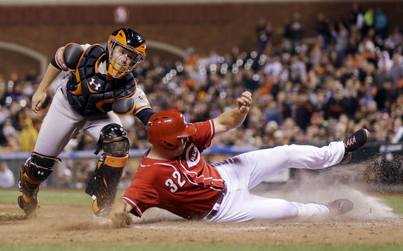 Cincinnati Reds' Jay Bruce (32) scores past San Francisco Giants catcher Buster Posey after a double from Todd Frazier during the fifth inning of the second game of a baseball doubleheader on Tuesday, July 23, 2013, in San Francisco. (AP Photo/Marcio Jose Sanchez)