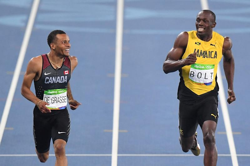 Jamaica's Usain Bolt (R) laughs with Canada's Andre De Grasse after they competed in the Men's 200m Semifinal during the athletics event at the Rio 2016 Olympic Games at the Olympic Stadium in Rio de Janeiro on August 17, 2016