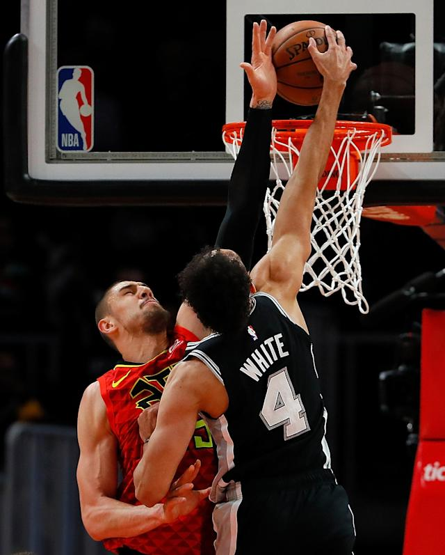 ATLANTA, GEORGIA - MARCH 06: Derrick White #4 of the San Antonio Spurs dunks against Alex Len #25 of the Atlanta Hawks in the first half at State Farm Arena on March 06, 2019 in Atlanta, Georgia. (Photo by Kevin C. Cox/Getty Images)