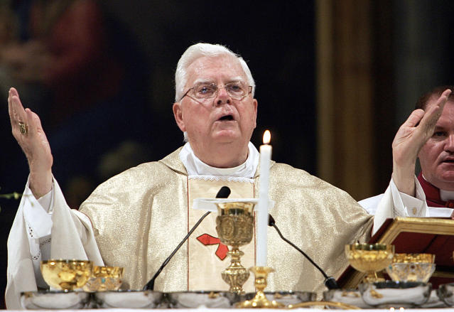 An official with the Catholic Church said Tuesday, Dec. 19, 2017, that Cardinal Bernard Law, the disgraced former archbishop of Boston, has died at 86. Law stepped down under pressure in 2002 over his handling of clergy sex abuse cases. (AP Photo/Domenico Stinellis, File)
