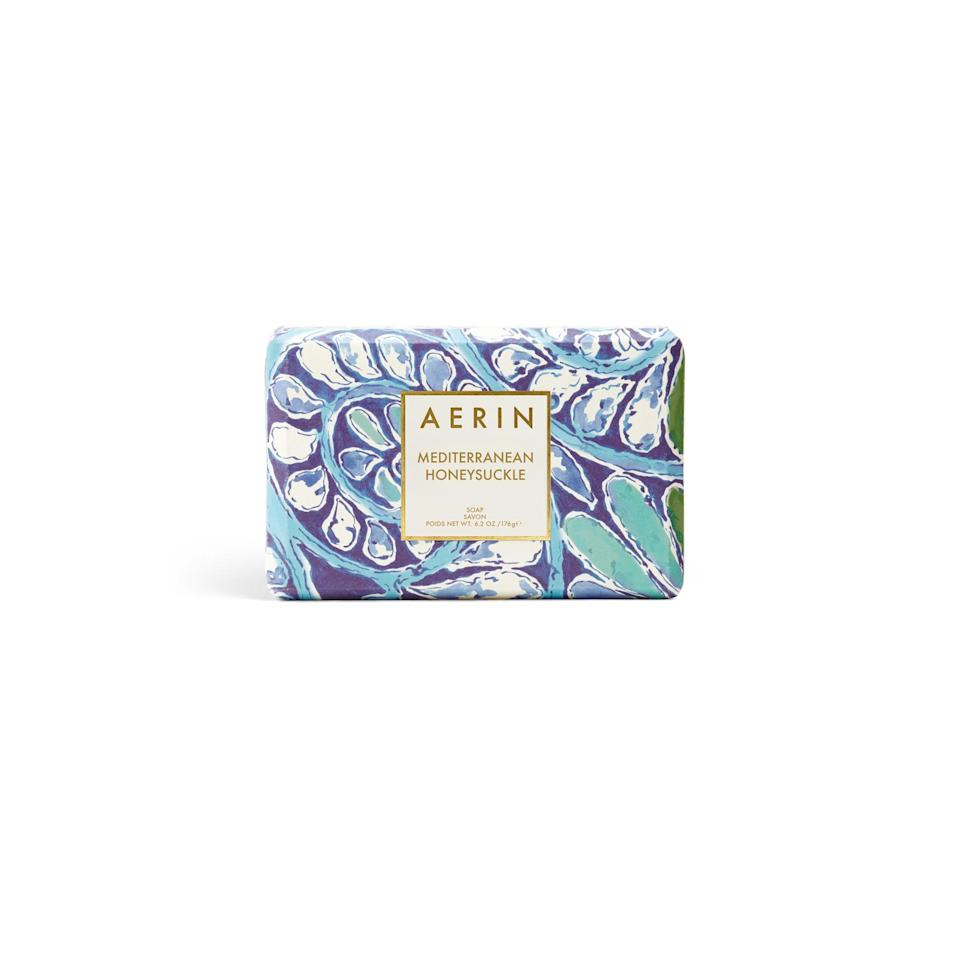 """<p>An armful of lilacs wrapped in brown paper presented alongside this transportive soap — which combines sweet honeysuckle with a sparkling grapefruit accord — will make for one of the most memorable, scent-filled celebrations she's ever experienced.</p><p>$20 (<a rel=""""nofollow"""" href=""""http://www.aerin.com/Mediterranean-Honeysuckle-Soap/14002628750,default,pd.html?mbid=synd_yahoobeauty#start=1"""">aerin.com</a>).</p>"""