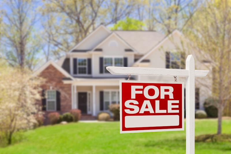Home For Sale Real Estate Sign and Beautiful New House