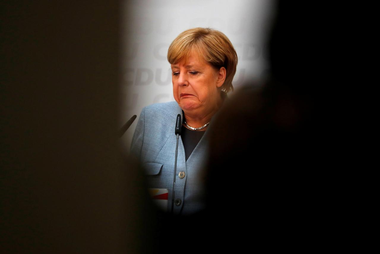 Christian Democratic Union CDU party leader and German Chancellor Angela Merkel reacts during a news conference at the CDU party headquarters, a day after the general election (Bundestagswahl) in Berlin, Germany September 25, 2017.   REUTERS/Fabrizio Bensch     TPX IMAGES OF THE DAY