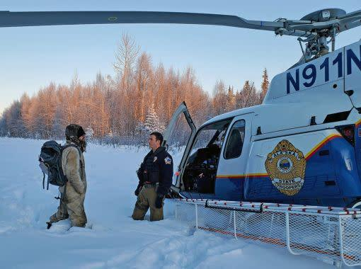 Tyson Steele is greeted by Alaska State Trooper's tactical flight officer Zac Johnson after more than 20 days in the wilderness. (Photo: Alaska DPS)
