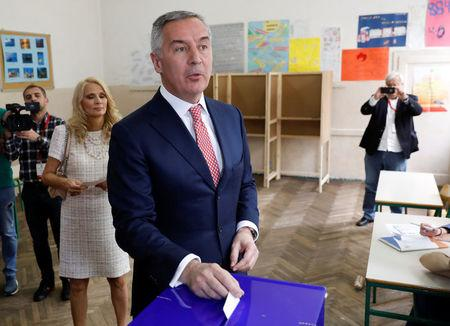 Milo Djukanovic, the presidential candidate of the ruling DPS party (Democratic party of Socialists), casts his vote during Montenegro's presidential election, in Podgorica, Montenegro April 15, 2018. REUTERS/Marko Djurica