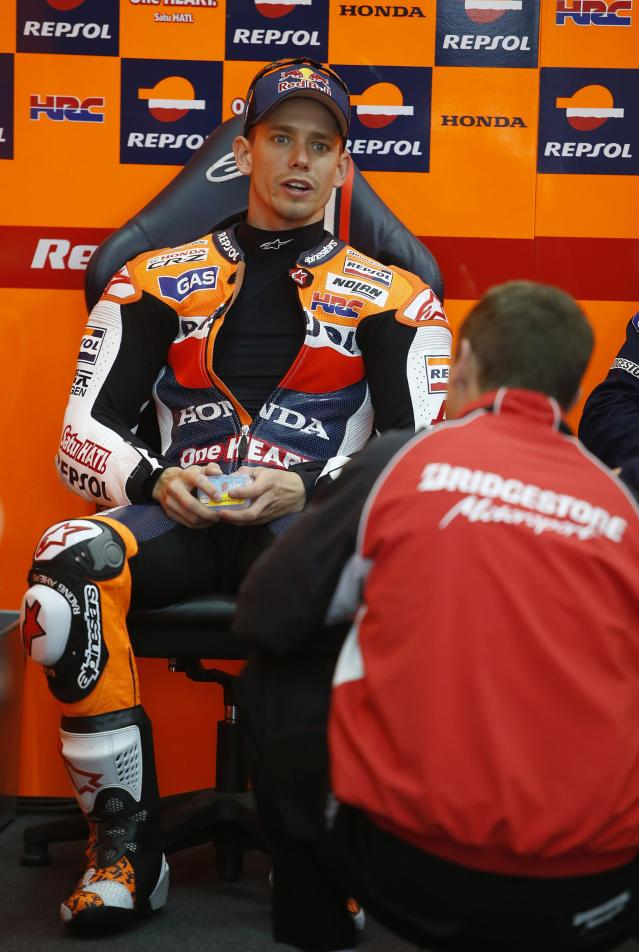 Repsol Honda Team's Australian rider Casey Stoner chats with staff inside the pit during the Moto GP Training session of the Valencia Grand Prix at Ricardo Tormo racetrack in Cheste, on November 9, 2012. AFP PHOTO/ JOSE JORDANJOSE JORDAN/AFP/Getty Images