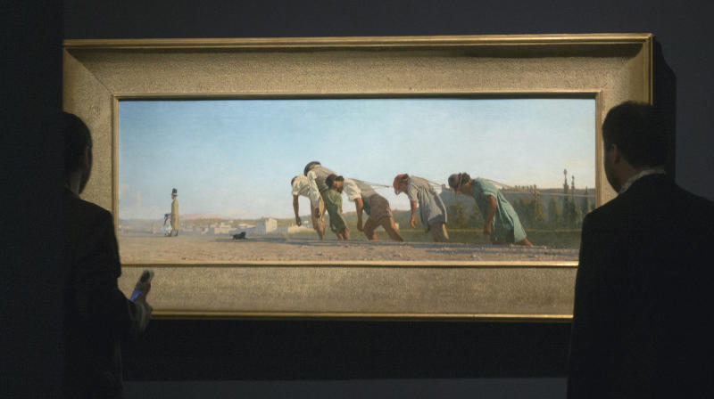 """Visitors looks at the painting """"towing scene in the Cascine park of Florene"""" (1864) painted by Telemaco Signorini, at the Orangerie Museum in Paris, Tuesday April 9, 2013. A new exhibit at Paris' Orangery museum called """"The Macchiaioli: the Italian Impressionists?"""" explores how a Florence-based art movement that predated French impressionism by a decade was already using the themes of light, the outdoors and spontaneity that's more associated with the likes of Monet or Renoir. (AP Photo/Jacques Brinon)"""