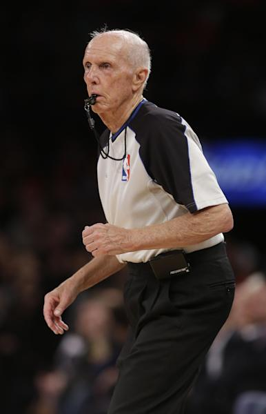 Referee Dick Bavetta works during the first half of an NBA basketball game between the New York Knicks and the Brooklyn Nets Wednesday, April 2, 2014, in New York. Bavetta worked his 2,633rd consecutive game assignment Wednesday, an ironman streak even longer than the one baseball Hall of Famer Cal Ripken Jr. compiled. The Knicks won the game 110-81. (AP Photo/Frank Franklin II)