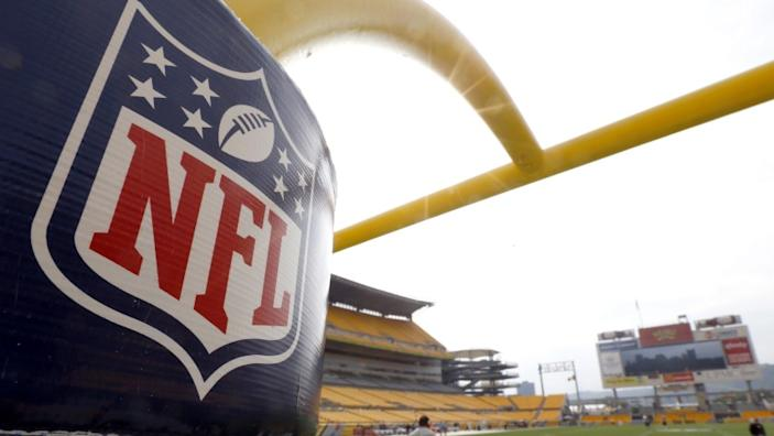 """The NFL shield logo is displayed on a goal post at Pittsburgh's Heinz Field in September 2013. <span class=""""copyright"""">(Keith Srakocic / Associated Press)</span>"""
