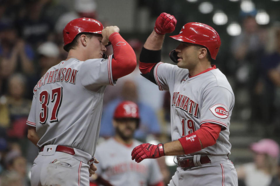 Cincinnati Reds' Joey Votto (19) is congratulated by Tyler Stephenson (37) after hitting a two-run home run during the seventh inning of a baseball game against the Milwaukee Brewers, Monday, June 14, 2021, in Milwaukee. (AP Photo/Aaron Gash)