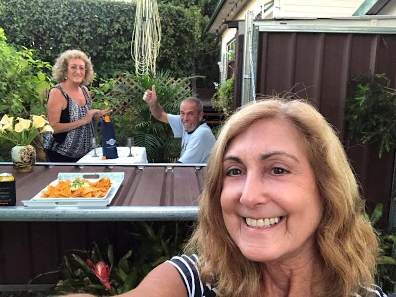 Linda Solomons poses with neighbours and friends of 35 years Jackie and Tony Cliffe over fence coronavirus DIY