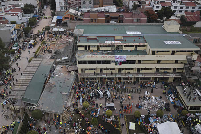 <p>Volunteers and rescue workers search for children trapped inside the Enrique Rebsamen school, collapsed by a 7.1 earthquake in southern Mexico City, Wednesday Sept. 20, 2017. (Photo: Miguel Tovar/AP) </p>