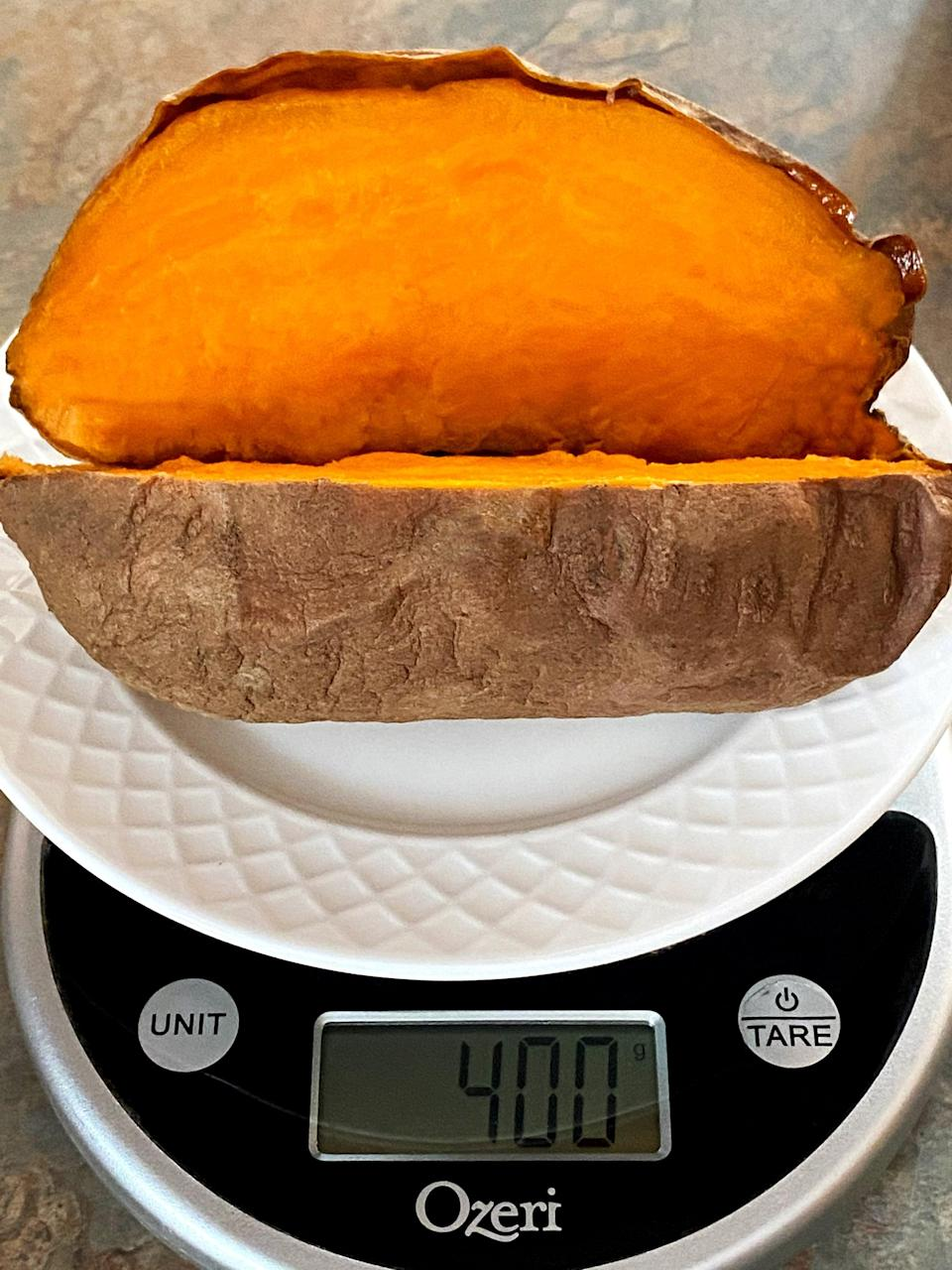 """<p>I don't weight or measure my food, but I was curious to know the <a href=""""https://www.popsugar.com/fitness/How-Many-Calories-Sweet-Potato-43399959"""" class=""""link rapid-noclick-resp"""" rel=""""nofollow noopener"""" target=""""_blank"""" data-ylk=""""slk:nutritional info"""">nutritional info</a> of the daily sweet potato I was eating. Of the three varieties I roasted, they were generously-sized weighing about 400 grams (sometimes 500). Here's the nutritional info from <a href=""""https://www.verywellfit.com/recipe-nutrition-analyzer-4157076"""" class=""""link rapid-noclick-resp"""" rel=""""nofollow noopener"""" target=""""_blank"""" data-ylk=""""slk:VeryWell.com"""">VeryWell.com</a> for 400 grams of a regular sweet potato (left) and a Japanese sweet potato (right). </p>  <p>90 percent of the time, I ate my sweet potato with one-pound (16 ounces) of steamed veggies, which is just a small bag you'd get in the freezer section. It offered about 125 calories, so this was a perfectly-sized 500- to 600-calorie meal for me. When I first started eating this lunch, I'd sprinkle Trader Joe's Everything But the Bagel Seasoning on the veggies, but after a week or so, I really enjoyed it plain!</p> <p>People often ask vegans, """"Where do you get your protein?"""" Just look at the protein from the sweet potato! The pound of broccoli adds another 10 grams.</p>"""