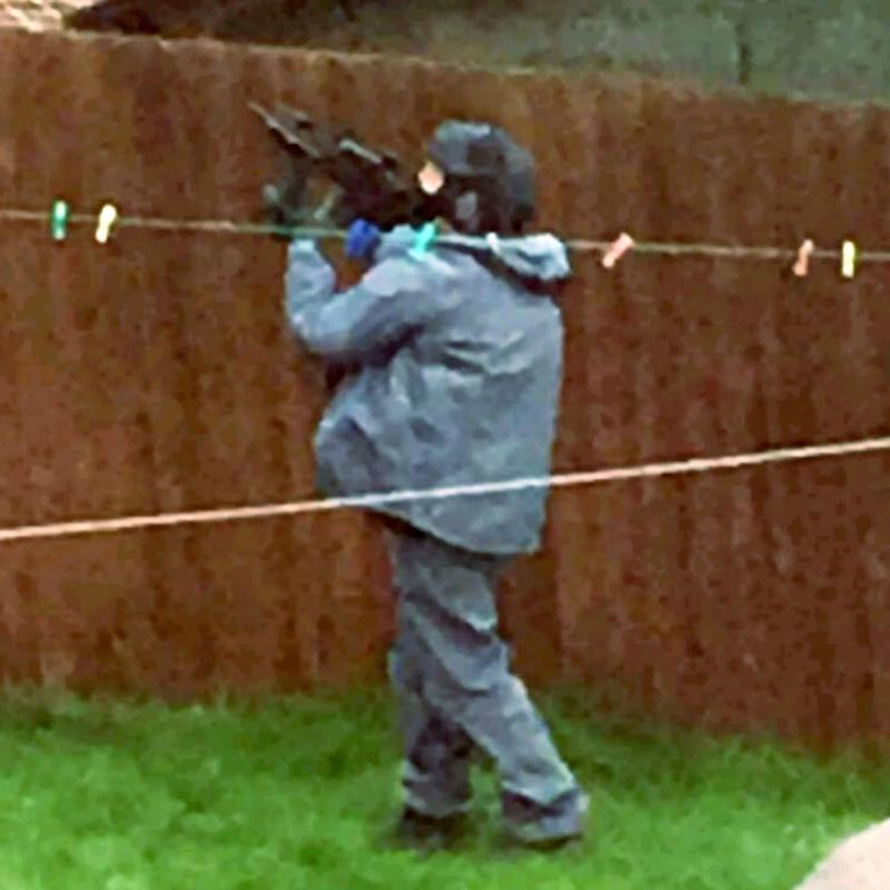 Armed police raided a house in Birmingham on Thursday - Credit: SWNS