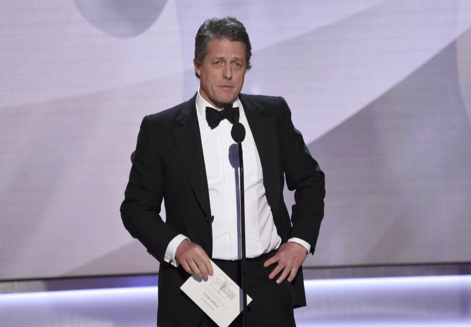 Hugh Grant presents the award for outstanding performance by an ensemble in a drama series at the 25th annual Screen Actors Guild Awards at the Shrine Auditorium & Expo Hall on Sunday, Jan. 27, 2019, in Los Angeles. (Photo by Richard Shotwell/Invision/AP)