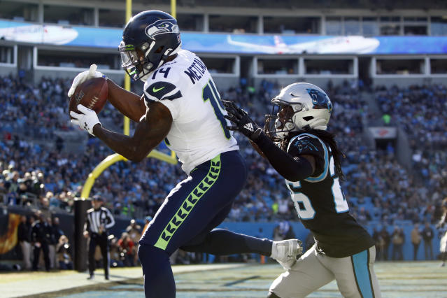 Seattle Seahawks wide receiver D.K. Metcalf (14) catches a touchdown pass as Carolina Panthers cornerback Donte Jackson chases during the first half of an NFL football game in Charlotte, N.C., Sunday, Dec. 15, 2019. (AP Photo/Brian Blanco)
