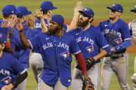 Toronto Blue Jays Vladimir Guerrero Jr. and pitcher Jordan Romano celebrates with their teammates after defeating the Miami Marlins 3-1, during a baseball game, Wednesday, June 23, 2021, in Miami. (AP Photo/Marta Lavandier)