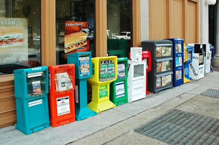 "<span class=""caption"">Read all about it: Virus kills off dying industry</span> <span class=""attribution""><a class=""link rapid-noclick-resp"" href=""https://www.gettyimages.com/detail/photo/newspaper-dispensing-machines-palofox-street-royalty-free-image/1008532788?adppopup=true"" rel=""nofollow noopener"" target=""_blank"" data-ylk=""slk:Brian Mitchell/Getty Images"">Brian Mitchell/Getty Images</a></span>"