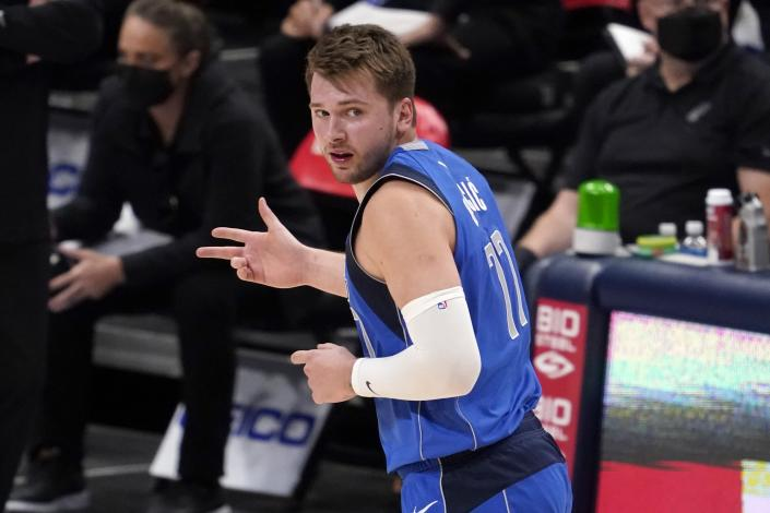 Dallas Mavericks guard Luka Doncic celebrates after sinking a three-point basket in the second half of an NBA basketball game against the San Antonio Spurs in Dallas, Sunday, April 11, 2021. (AP Photo/Tony Gutierrez)