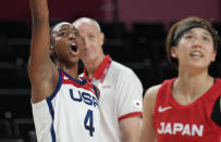 United States' Jewell Loyd (4), left, reacts as she watches a shot during women's basketball preliminary round game at the 2020 Summer Olympics, Friday, July 30, 2021, in Saitama, Japan. (AP Photo/Eric Gay)