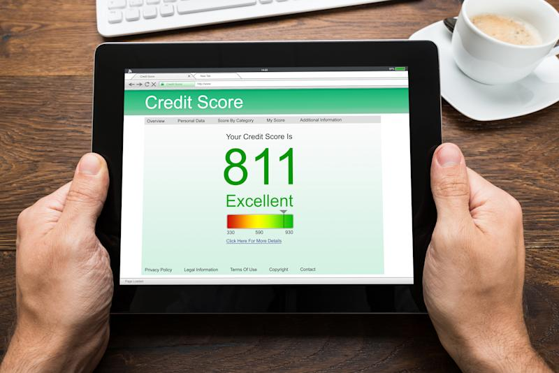 Tablet showing an 811 credit score.