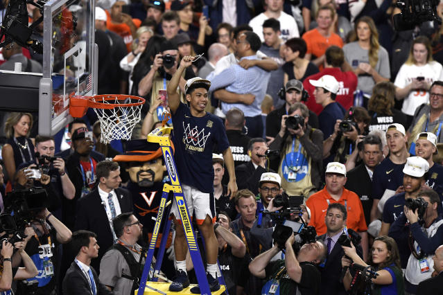 Kihei Clark #0 of the Virginia Cavaliers cuts down the net after his teams 85-77 win over the Texas Tech Red Raiders during the 2019 NCAA men's Final Four National Championship game at U.S. Bank Stadium on April 08, 2019 in Minneapolis, Minnesota. (Photo by Hannah Foslien/Getty Images)