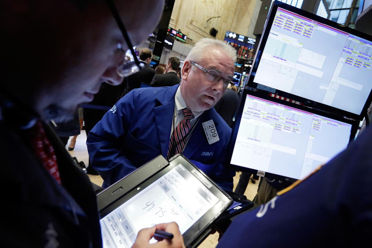 <p> FILE - In this Monday, Sept. 26, 2016, file photo, trader James Dresch, center, works on the floor of the New York Stock Exchange. Energy stocks led most markets higher on Thursday, Sept. 29, after OPEC nations reached a preliminary deal to cut oil production for the first time in eight years. (AP Photo/Richard Drew, File) </p>