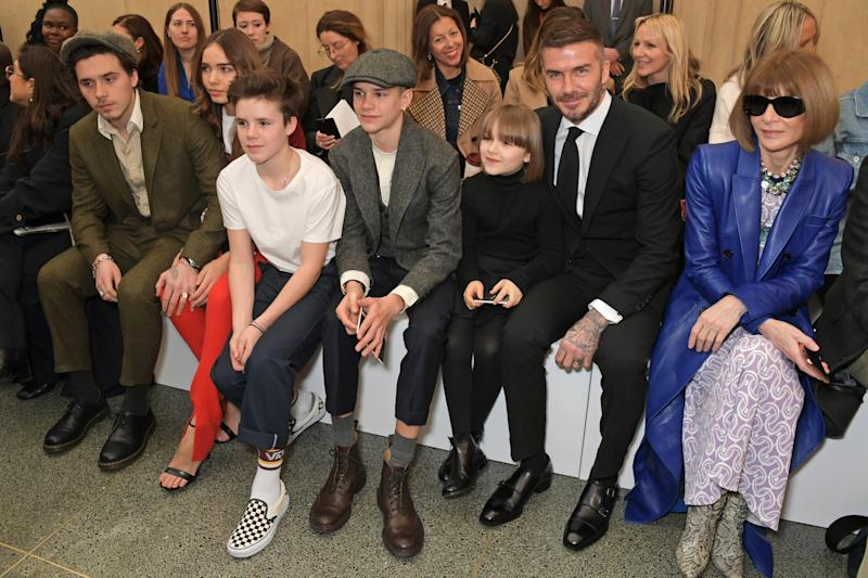 LONDON, ENGLAND - FEBRUARY 17: (L to R) Brooklyn Beckham, Hana Cross, Cruz Beckham, Romeo Beckham, Harper Beckham, David Beckham and Dame Anna Wintour attend the Victoria Beckham show during London Fashion Week February 2019 at Tate Britain on February 17, 2019 in London, England. (Photo by David M. Benett/Dave Benett/Getty Images)