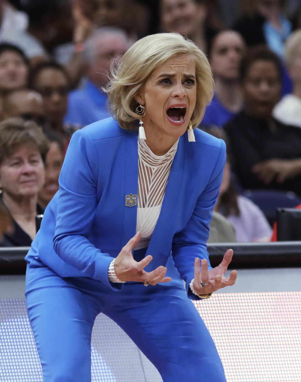 FILE - In this April 7, 2019 file photo, Baylor coach Kim Mulkey encourages her team during the first half against Notre Dame in the Final Four championship game of the NCAA women's college basketball tournament in Tampa, Fla. Mulkey is part of a nine-person group announced Saturday, April 4, 2020, as this years class of enshrinees into the Naismith Memorial Basketball Hall of Fame. (AP Photo/Chris O'Meara, File)
