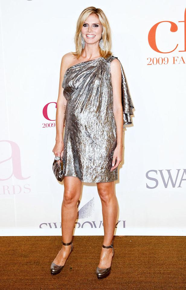 """A very pregnant Heidi Klum glowed in a crushed silver Michael Kors asymmetrical mini, statement earrings, and matching Christian Louboutin heels. Ach/<a href=""""http://www.infdaily.com"""" target=""""new"""">INFDaily.com</a> - June 15, 2009"""