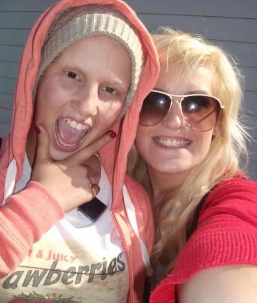 Livi Deane, shown here while fighting cancer, with her mum. (Supplied)