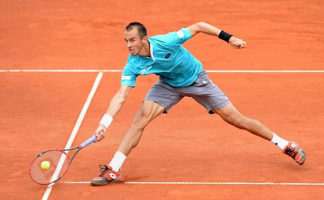 Lukas Rosol of Czech Republic returns the ball during his quarter-final match against Britain's Andy Murray at the ATP Tennis Open in Munich, southern Germany, on May 2, 2015 (AFP Photo/Christof Stache)