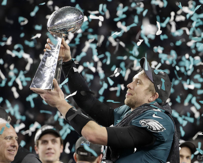 Philadelphia Eagles QB Nick Foles holds up the Vince Lombardi Trophy after last season's Super Bowl. (AP)