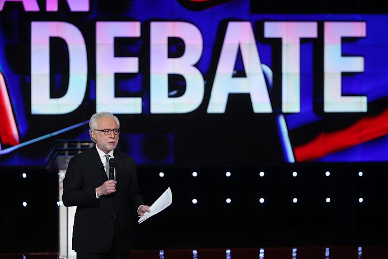 CNN anchor Wolf Blitzer speaks before the first round of the CNN Republican presidential debate on December 15, 2015 in Las Vegas, Nevada.   Justin Sullivan—Getty Images