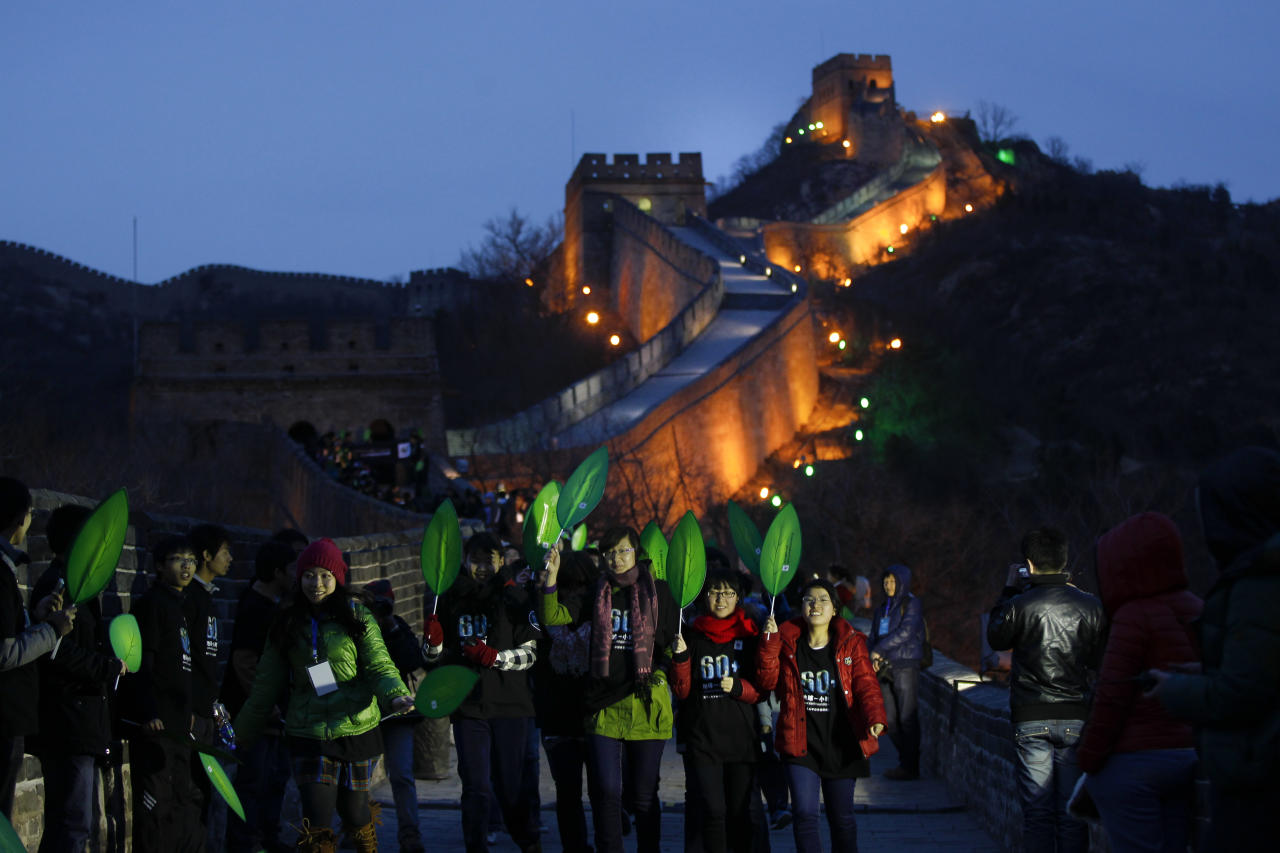 University students participate in a mini marathon in conjunction during the earth hour at the Great Wall of China in north of Beijing, China, Saturday, March 31, 2012. Hundreds of landmarks around the world including Washington's National Cathedral, London's Clock Tower, the Great Wall of China and Tokyo Tower will be dimmed at 8:30 p.m. local time, as part of a global effort to shine a spotlight on climate change. (AP Photo/ Vincent Thian)