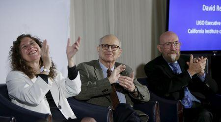 (L-R) Doctors Gabriela Gonzalez, Rainer Weiss and Kip Thorne applaud the announcement of the detection of gravitational waves, ripples in space and time hypothesized by physicist Albert Einstein a century ago, in Washington February 11, 2016. REUTERS/Gary Cameron