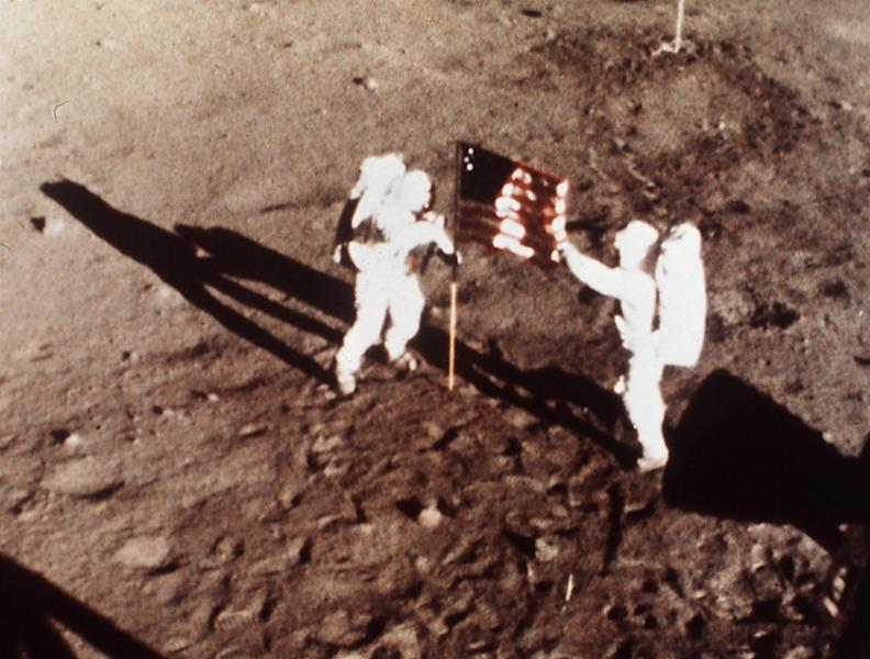 """FILE - In this July 20, 1969, file photo, provided by NASA, Apollo 11 astronauts Neil Armstrong and Edwin E. """"Buzz"""" Aldrin, the first men to land on the moon, plant the U.S. flag on the lunar surface. The family of Neil Armstrong, the first man to walk on the moon, says he has died at age 82 on Saturday, Aug. 25, 2012. Armstrong commanded the Apollo 11 spacecraft that landed on the moon July 20, 1969. He radioed back to Earth the historic news of """"one giant leap for mankind."""" (AP Photo/NASA, File)"""