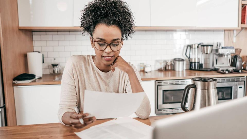 woman reviewing her paycheck and FICA tax