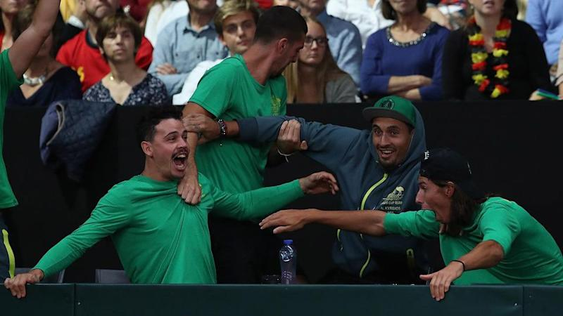 Kyrgios was part of the excited bench during the doubles. Pic: Getty