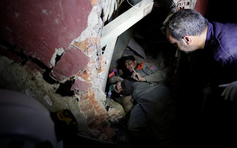 Lebanese soldiers search for survivors underneath the rubble - Hassan Ammar /AP