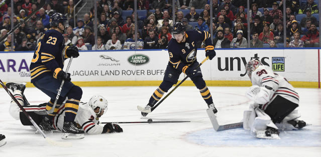 Chicago Blackhawks defenseman Brent Seabrook (7) goes to the ice to block a shot by Buffalo Sabres center Jack Eichel (9) during the second period of an NHL hockey game in Buffalo, N.Y., Friday, Feb. 1, 2019. (AP Photo/Adrian Kraus)