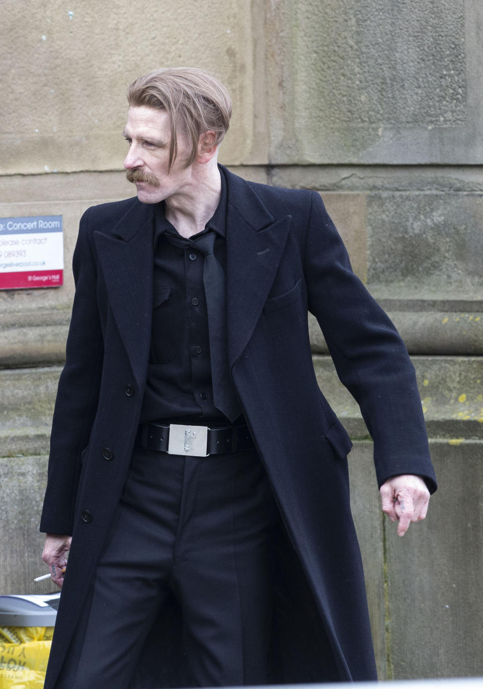 Paul Anderson, who plays Arthur Shelby, takes a break from filming. Peaky Blinders start filming in Liverpool, at St George's Hall, as season 6 gets underway, pictured in Liverpool city centre, March 4 2021. (SWNS)