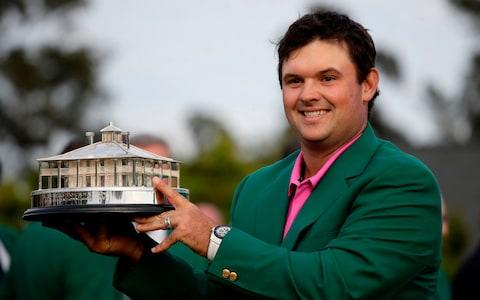 Patrick Reed holds the championship trophy after winning the Masters golf tournament Sunday, April 8, 2018, in Augusta, Ga. - Credit: AP
