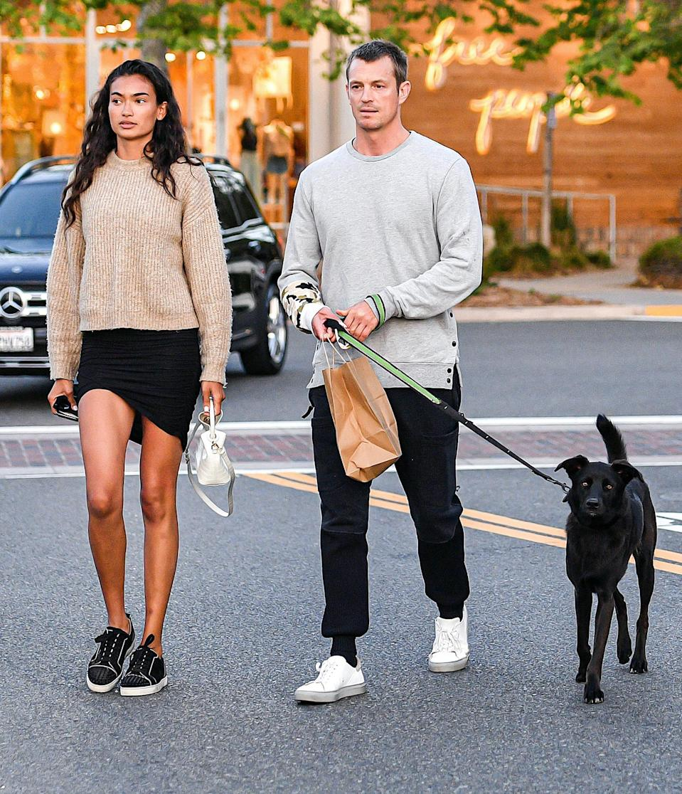 <p>Joel Kinnaman and fiancé Kelly Gale take their rescue dog Zoe for a walk after dinner at Taverna Tony's in Malibu on Wednesday.</p>