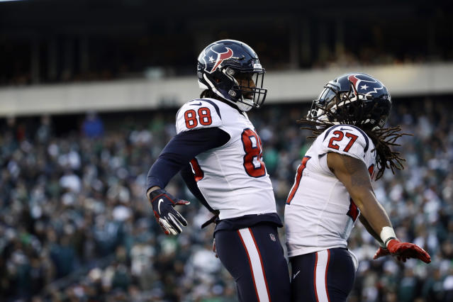 Houston Texans' D'Onta Foreman, right, and Jordan Akins celebrate after Foreman's touchdown during the second half of an NFL football game against the Philadelphia Eagles, Sunday, Dec. 23, 2018, in Philadelphia. (AP Photo/Matt Rourke)