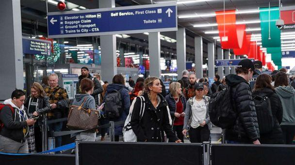 PHOTO: Travelers queue during the Thanksgiving holiday travel rush at O'Hare Airport in Chicago, Nov. 27, 2019. (Kamil Krzaczynski/Reuters)
